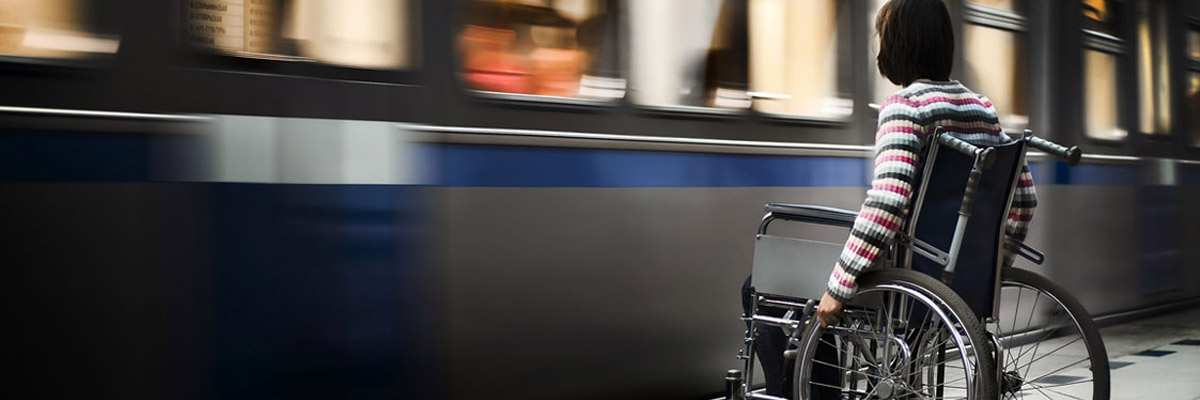Person in wheelchair waiting for a train
